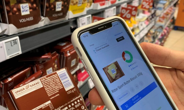 Shopper scans a bar of chocolate in Egelsbach's Rewe-Center (Germany) with the Codecheck application. (Photo: Retail Optimiser)
